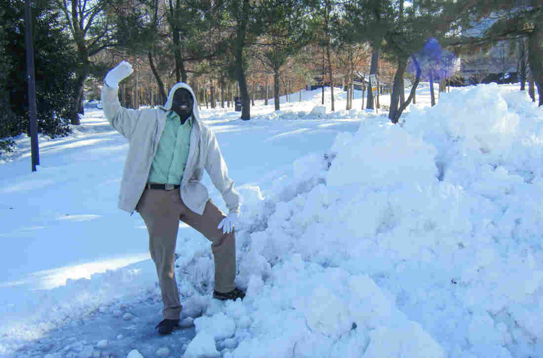 Manyang Reath had never seen snow until he moved from Sudan to Richmond, Va., in 2005. Here he is in 2008, embracing it.