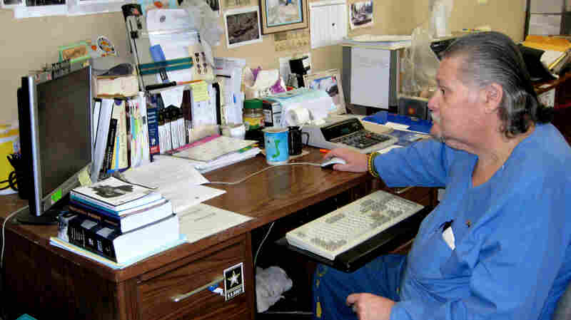 Inmate and Vietnam veteran Ed Munis works on his computer at the Veteran Service Office in California's Soledad Correctional Training Facility, which he helped start more than a decade ago.