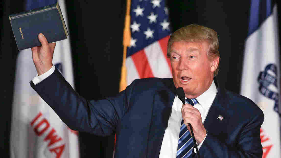 Republican presidential candidate Donald Trump holds up a Bible during a campaign stop in Council Bluffs, Iowa.