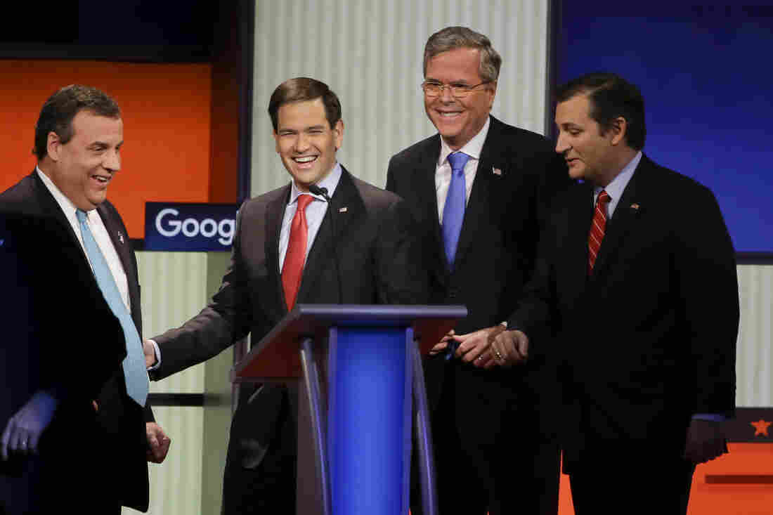 New Jersey Gov. Chris Christie, Sen. Marco Rubio, R-Fla., former Florida Gov. Jeb Bush and Sen. Ted Cruz, R-Texas, talk after the Republican presidential primary debate on Thursday.