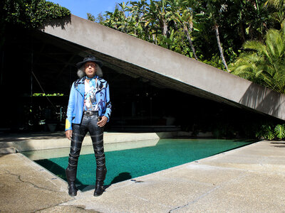 Goldstein — who has his own fashion line — poses in front of his home. (Danny Hajek/NPR)