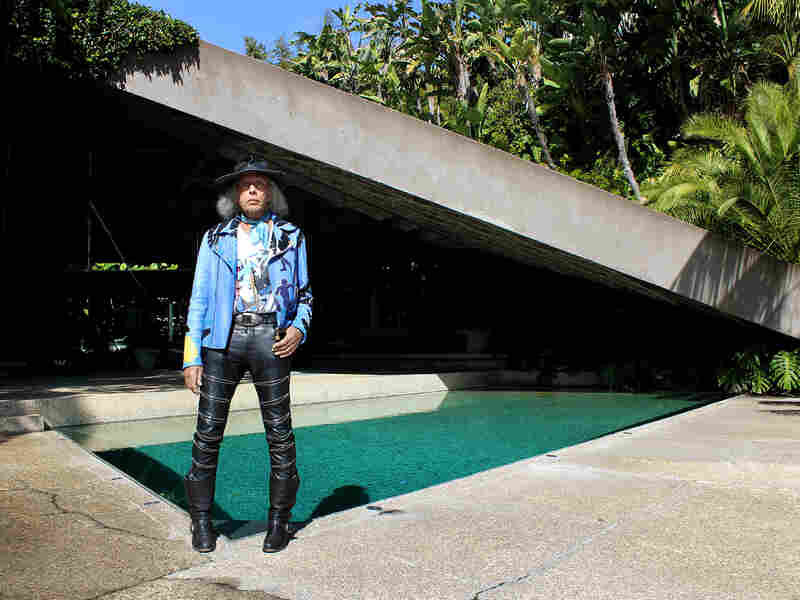 Goldstein — who has his own fashion line — poses in front of his home.