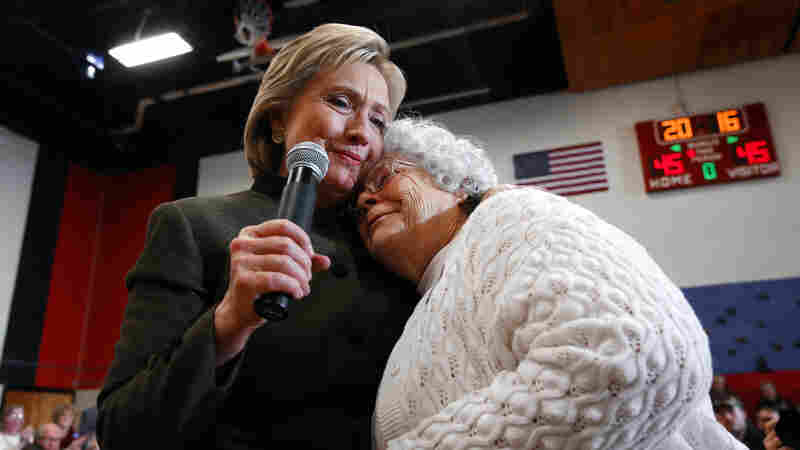 Democratic presidential candidate Hillary Clinton (left) hugs Annette Bebout, 73, of Newton, during a campaign event at Berg Middle School, in Newton, Iowa, this week. Bebout told her story to the audience of how she lost her home.