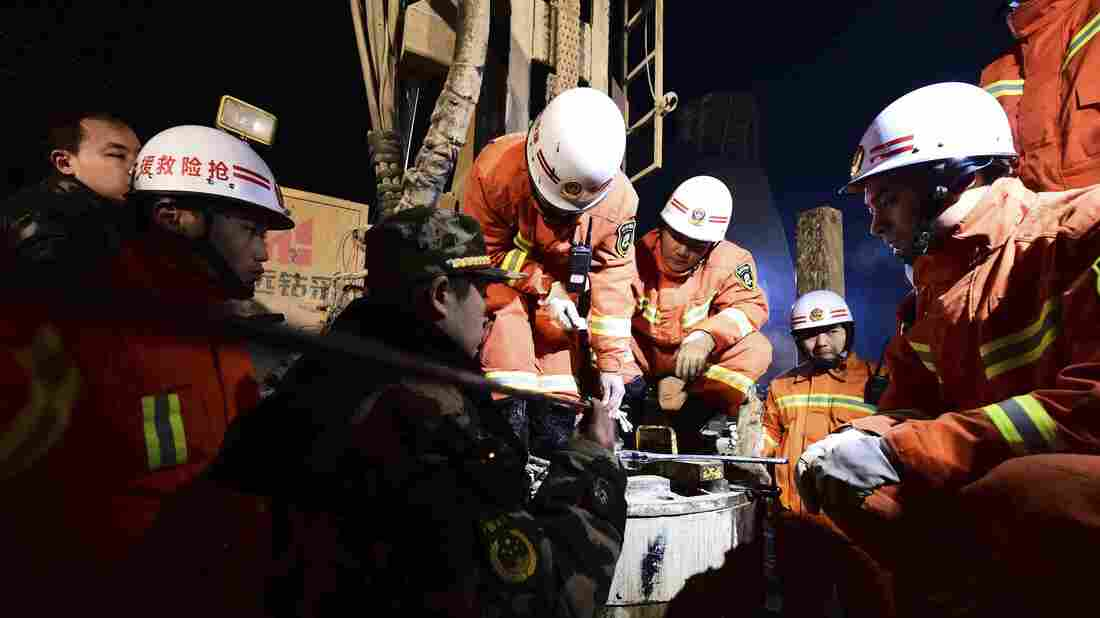 On Dec. 28, 2015, rescue workers try to contact men trapped by a mine collapse in east China's Shandong province. Four survivors have now been raised to the surface after 36 days.
