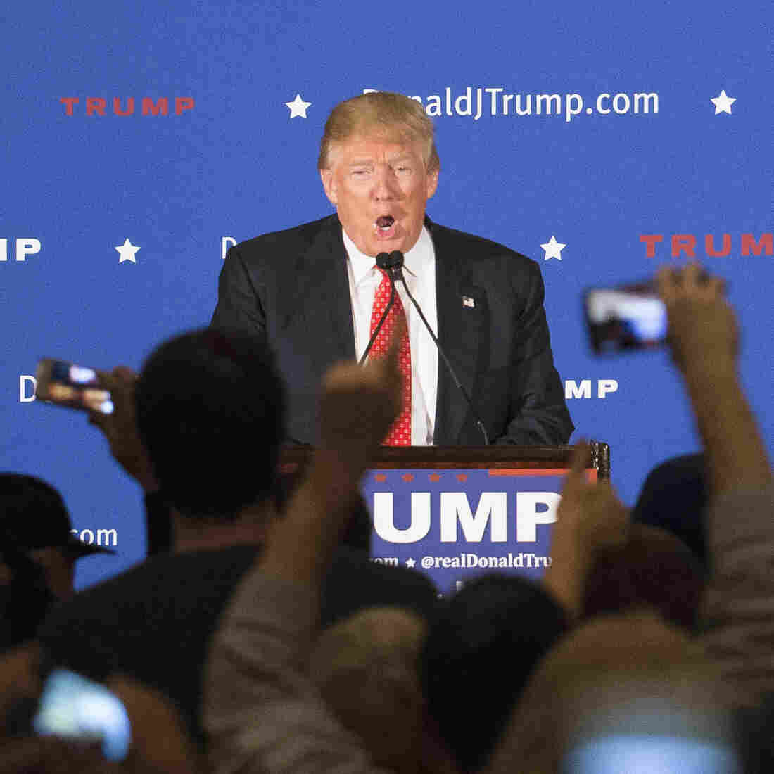 Republican presidential candidate Donald Trump speaks as the crowd applauds during a campaign stop at the Radisson Hotel in Nashua, N.H., on Friday.