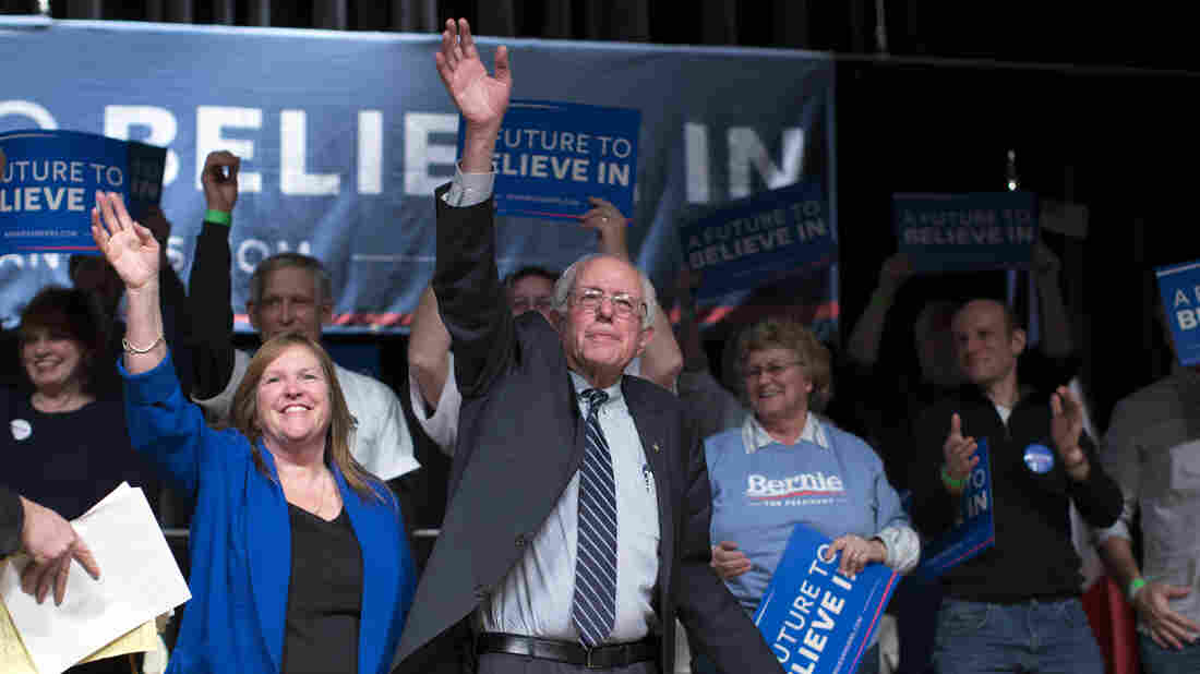 Democratic presidential candidate Sen. Bernie Sanders and his wife Jane Sanders wave to the crowd during a campaign rally in Burlington, Iowa.