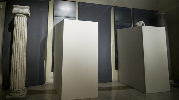 Ahead of a press conference with Premier Matteo Renzi and Iranian President Hassan Rouhani, wooden panels were erected around some Roman statues in Rome's Capitoline Museums. (AP)