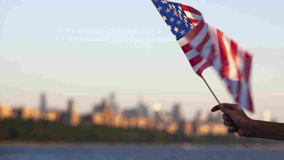 An American flag flown in front of the Hudson River in New York.