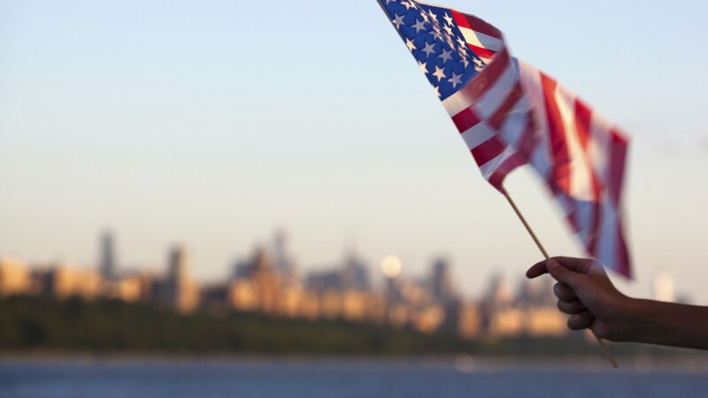 An American flag flown in front of the Hudson River in New York. (Jan Willem van Hofwegen/iStock)