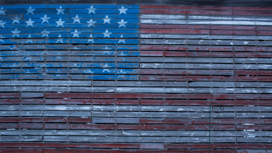 An American flag is painted on the side of a barn outside Webster City, Iowa. (Brendan Hoffman/Getty Images)
