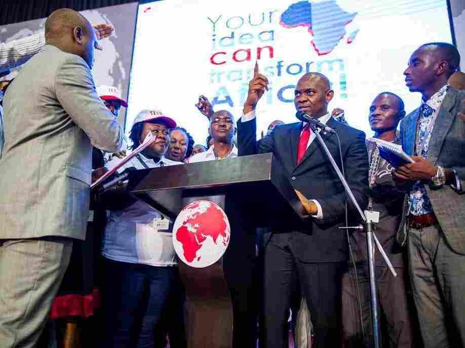Nigerian billionaire Tony Elumelu hopes to create job opportunities by investing in African startups. Above: Elumelu, center right, speaks at an entrepreneurship event in July 2015.