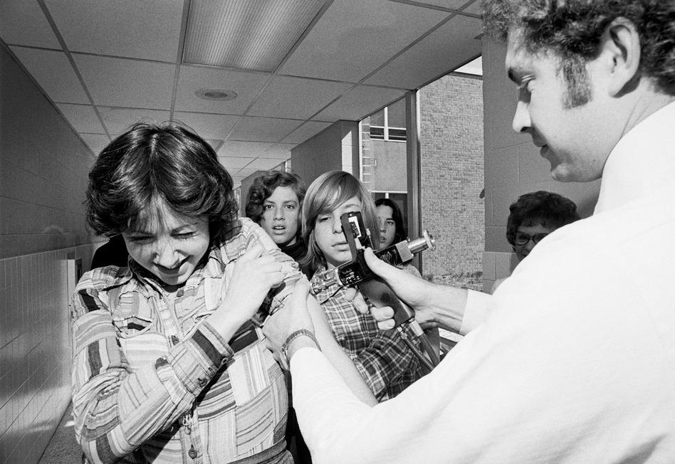 Diane McMenamin, 14, gets vaccinated against rubella at a high school in Willingboro, N.J., in 1976. (Bettmann/Corbis)