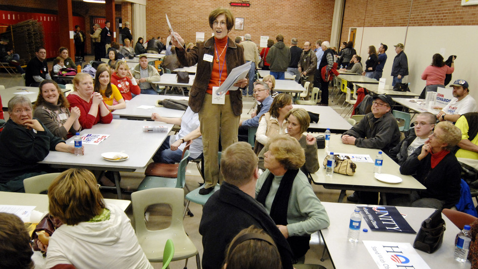 Precinct Chairwoman Judy Wittkop explains the rules during a 2008 Democratic caucus in Le Mars, Iowa. (Dave Weaver/AP)