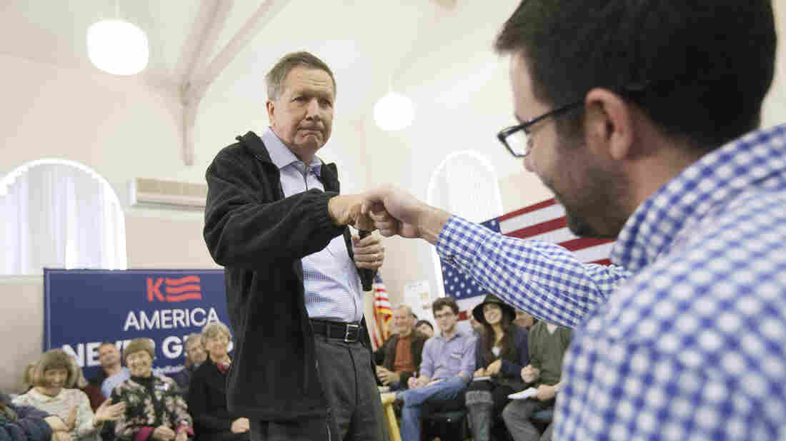 John Kasich fist bumps an attendee as he speaks during a campaign stop at the Historical Society of Cheshire County in Keene, N.H., on Saturday.