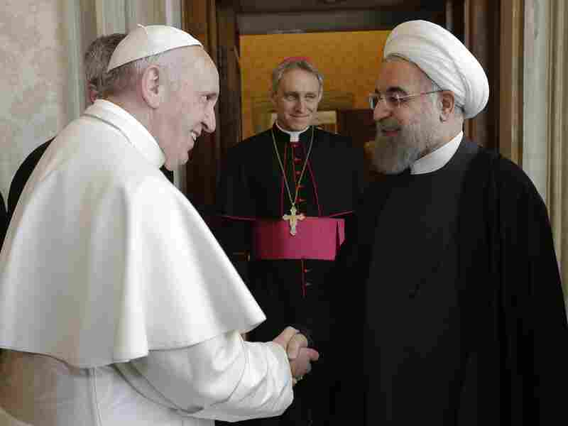 Pope Francis (L) welcomes Iranian President Hassan Rouhani for their private audience on January 26, 2016, at the Vatican.