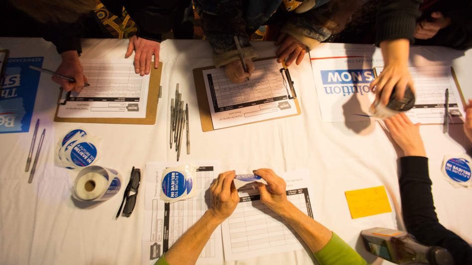 Guests sign in for a Bernie Sanders campaign event in Marshalltown, Iowa, in January. One big question is whether Sanders and outsider Donald Trump, who have been attracting large crowds, can get their supporters to caucus. (Getty Images)