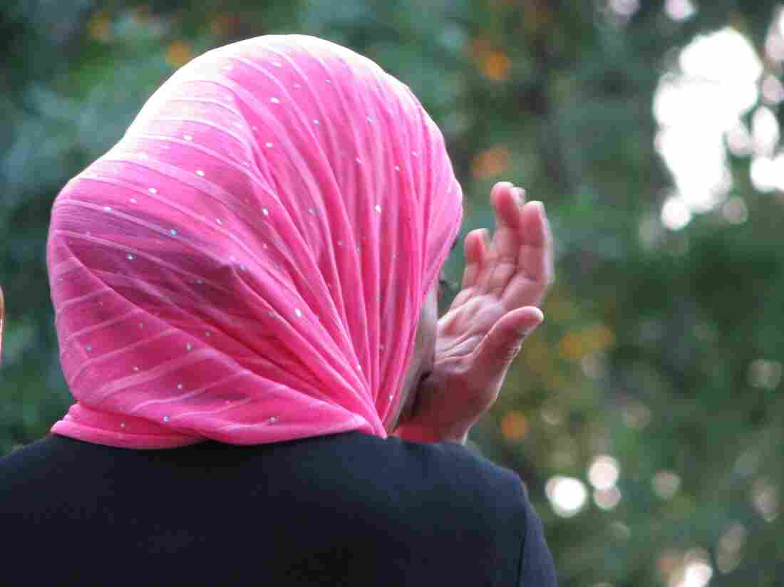 A woman wearing a headscarf.