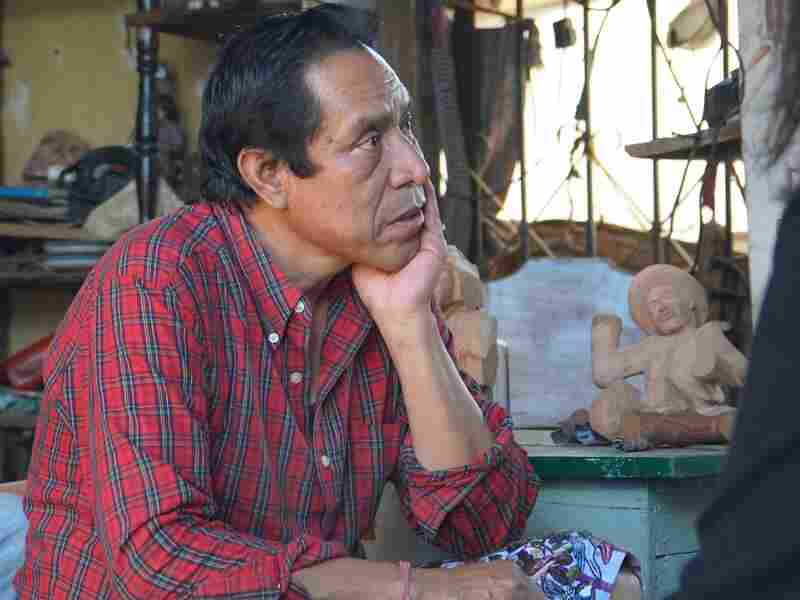 Guatemalan woodcarver Nicolas Chavez creates traditional Mayan figures at his rooftop workshop and sells them on Novica's website.