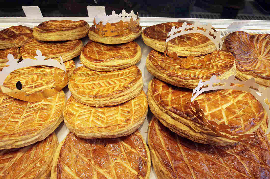 Crowns top traditional galette des rois (king cakes) baked for the Epiphany, or Kings Day, at a bakery in Paris. These French king cakes consist of layers of puff pastry filled with almond cream.