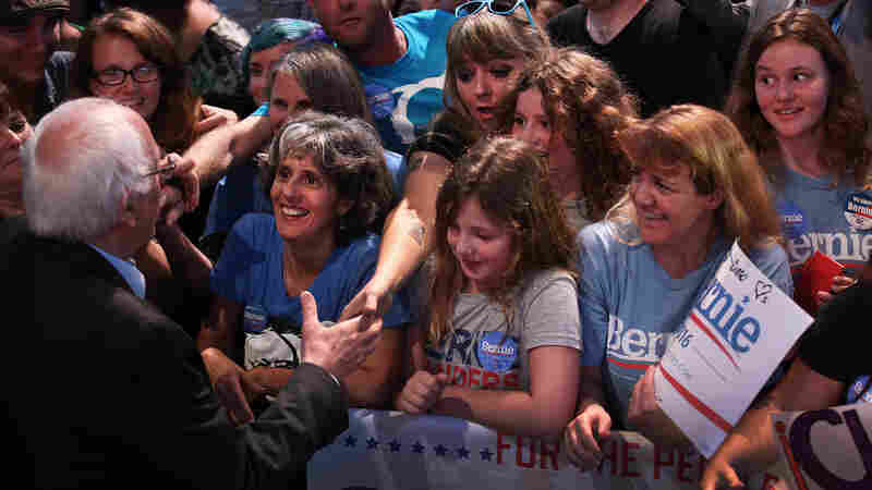 Bernie Sanders greets the audience at a fundraising event and rally.