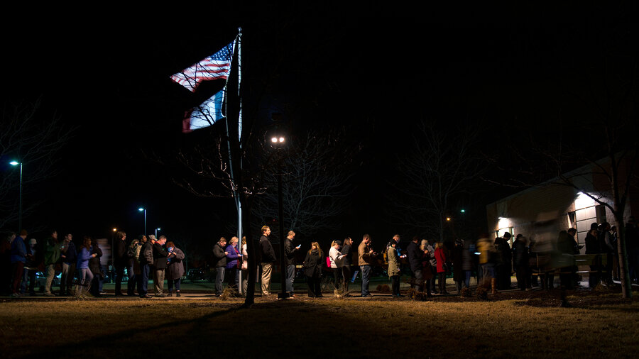 Caucus-goers line up outside a Democrat Party caucus held at Maple Grove Elementary in West Des Moines, Iowa.