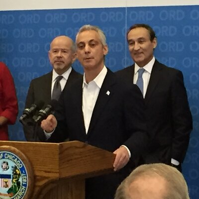 Chicago Mayor Rahm Emanuel announces an agreement to build a sixth runway at O'Hare International Airport, flanked by FAA Administrator Michael Huerta, left, and United Airlines President and CEO Oscar Munoz. (David Schaper/NPR)