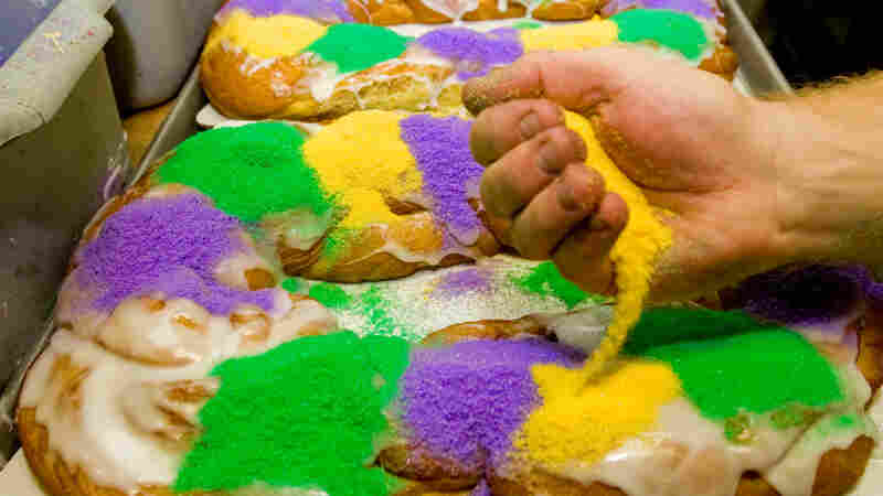 King cakes come in various interpretations around the world. In New Orleans, the baked treats are sugared with the official colors of Mardi Gras: purple, green and gold. And during Carnival season, the entire city falls under the sway of king cake obsession.