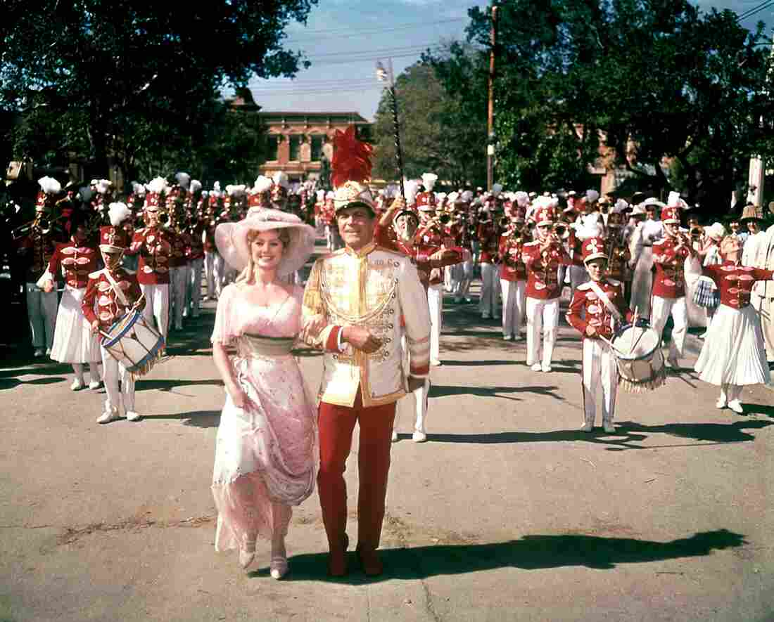 Shirley Jones and Robert Preston star in 1962's The Music Man, about a con man who poses as a band leader.
