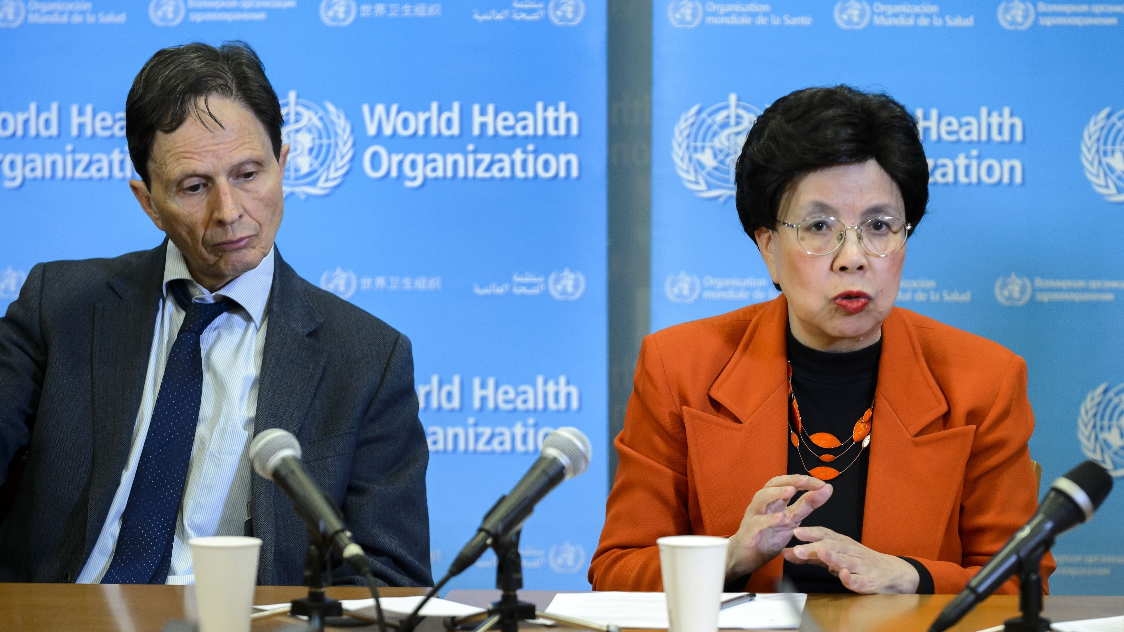Dr. Margaret Chan, director-general of the World Health Organization, and Dr. David L. Heymann, WHO assistant director-general, announce the global emergency during a news conference Monday in Geneva.