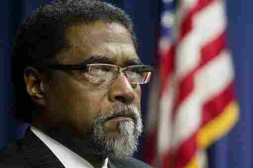 In this Sept. 11, 2013 photo, Saginaw City Manager Darnell Earley appears at a news conference in Flint, Mich. Earley was in charge of both the city of Flint and the schools at key points in their recent turmoil.