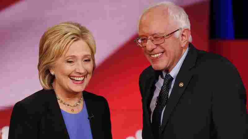 Democratic presidential candidates, Hillary Clinton and Sen. Bernie Sanders, smile during a break of the Democratic presidential debate on Jan. 17, 2016.