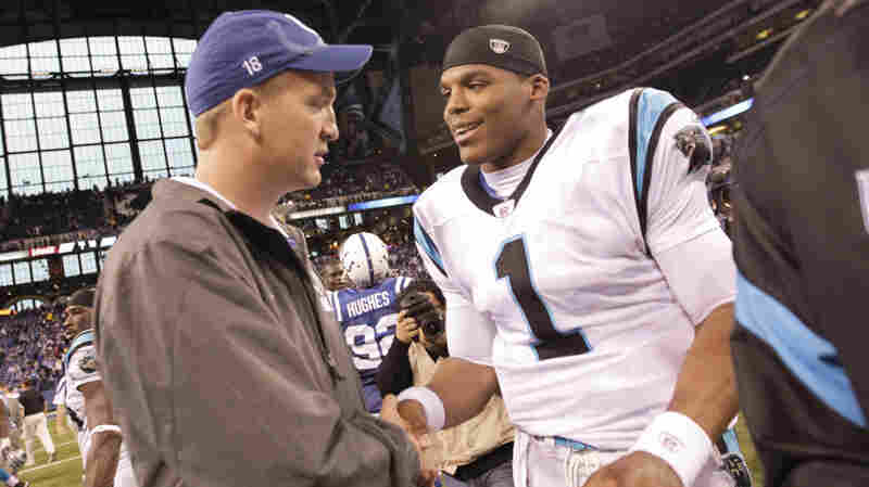 Indianapolis Colts quarterback Peyton Manning meets with Carolina Panthers quarterback Cam Newton after an NFL game in Indianapolis in 2011. Manning and Newton will square off in the 50th Super Bowl, in Santa Clara, Calif., on Sunday. The two quarterbacks were No. 1 overall draft picks 13 years apart.