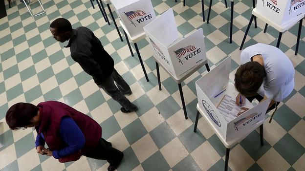 Voters cast ballots in November 2014 at Lake Shawnee park in Topeka, Kan. (AP)