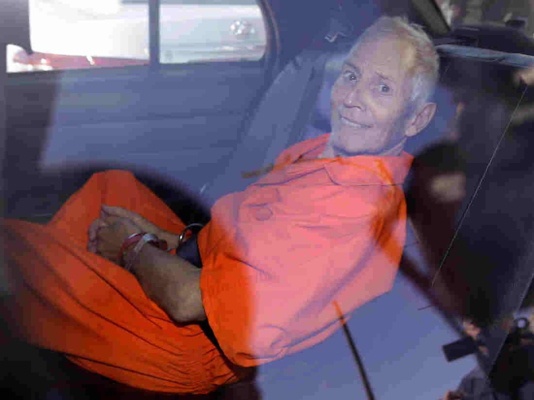 Robert Durst sits in a police vehicle following a court appearance in New Orleans on March 17, 2015.