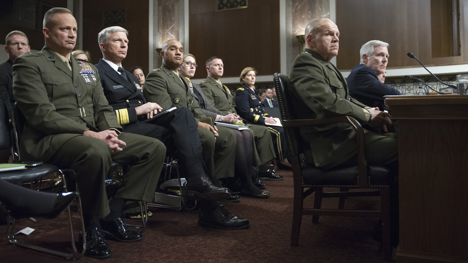 Navy Secretary Raymond Mabus (far right) and (to his right) Marine Corps Gen. Robert Neller testify Tuesday on Capitol Hill during a Senate Armed Services Committee hearing.