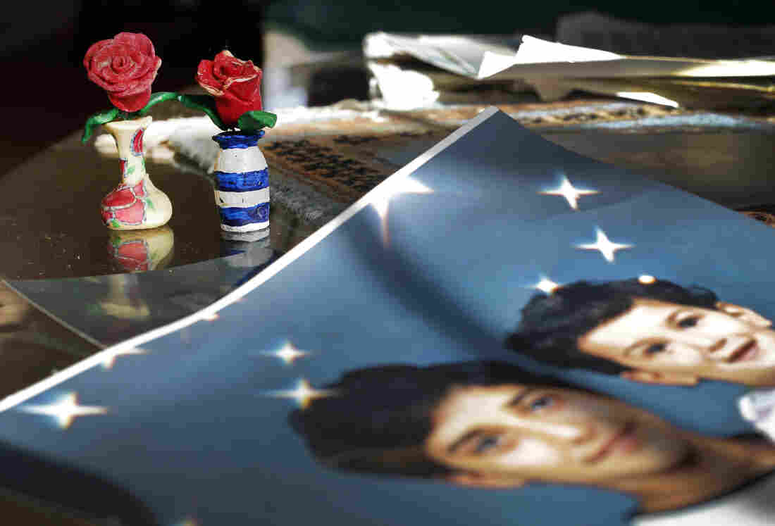 On Dec. 10, 2014, prison artwork created by Adnan Syed sits near family photos in the Baltimore home of his mother, Shamim Syed. Syed, convicted in 2000 of murdering his girlfriend, is appearing at a hearing Wednesday to request a new trial, based on evidence uncovered by the podcast Serial.