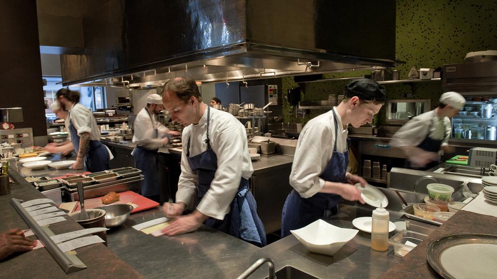Chef Eric Ziebold (center left) works with his kitchen staff at CityZen in Washington, D.C., in 2012. CityZen closed in 2014 when Ziebold left to open his own restaurant.