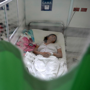 A patient suffering from Guillain-Barre syndrome recovers in a hospital ward in San Salvador on Jan. 27. Researchers are trying to determine whether there is a link between the disorder, which can cause weakness and paralysis, and the mosquito-borne Zika virus.