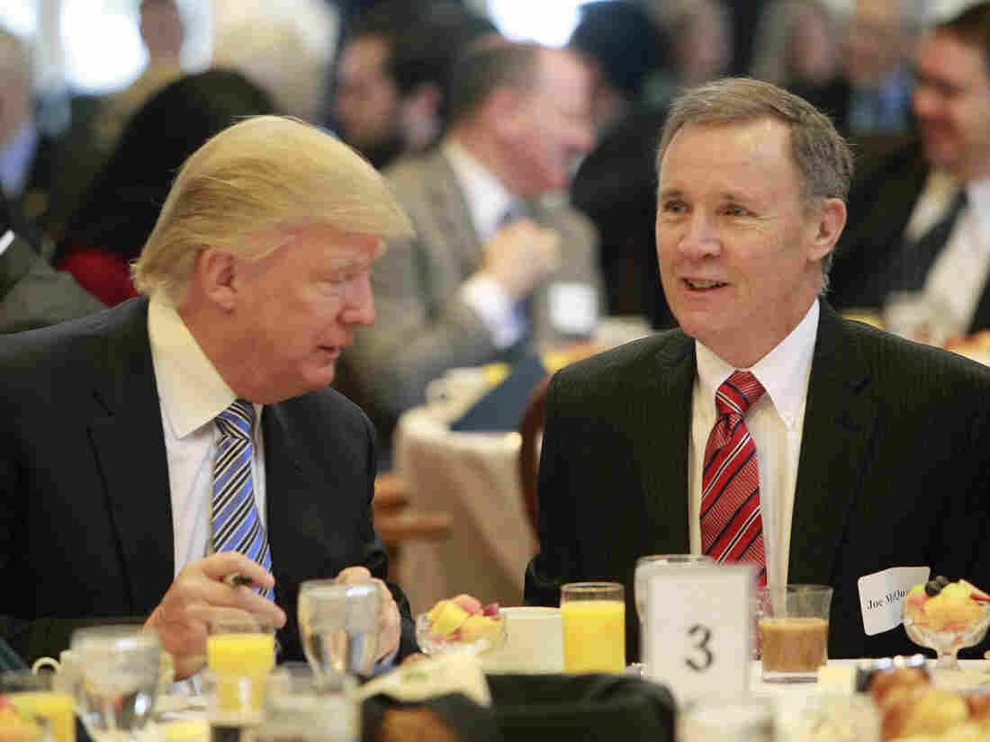 During more cordial times, Donald Trump (left) talks with New Hampshire Union Leader Publisher Joe McQuaid during a Politics and Eggs breakfast in Manchester, N.H., in 2014.