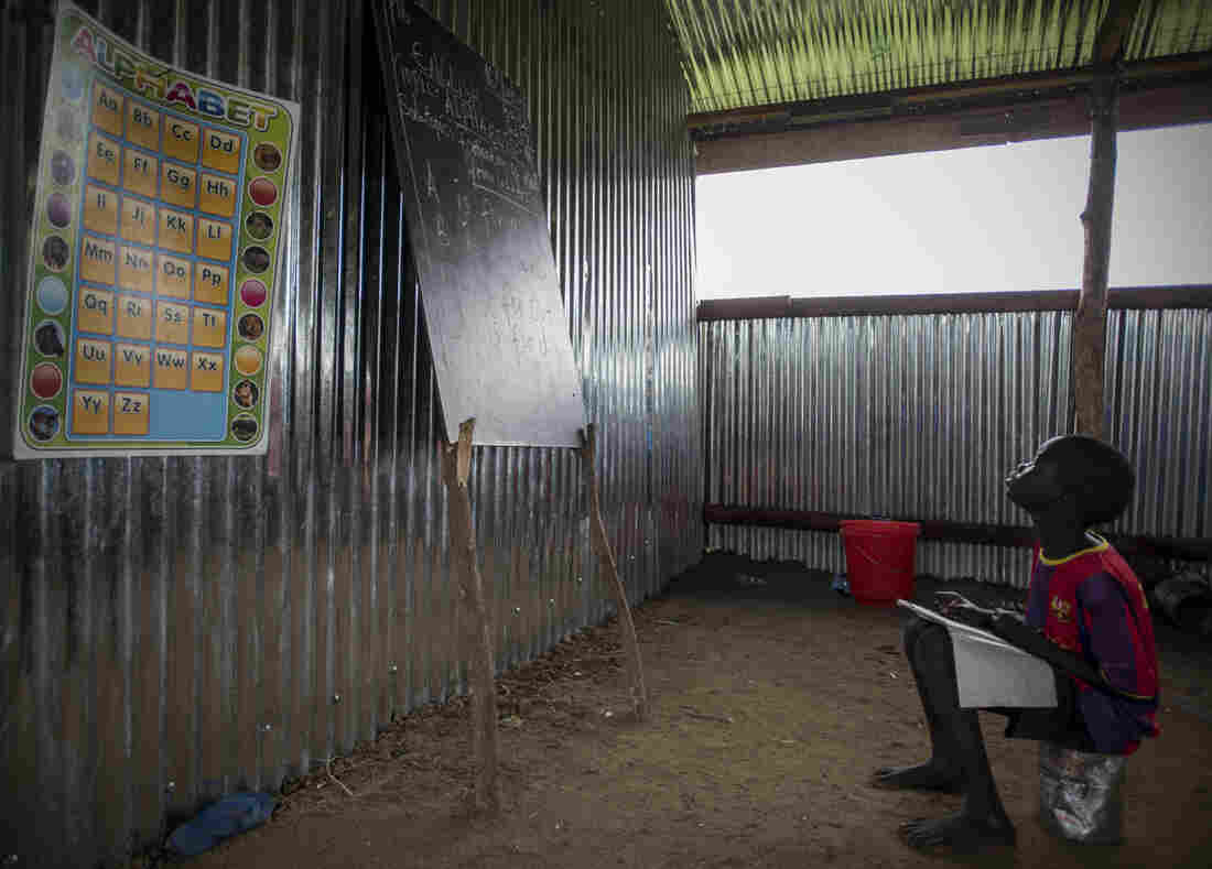 A child in South Sudan studies in a school. Fewer than half of the school-age kids are in school in South Sudan, one of the world's poorest countries, which has also been plagued by war.
