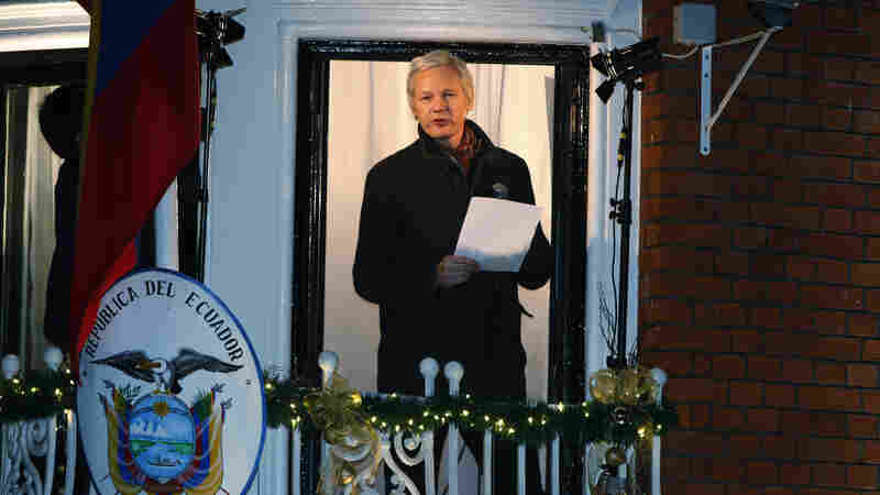 WikiLeaks founder Julian Assange reads a statement from the balcony of the Ecuadorean Embassy in central London in 2012. Assange took refuge at the embassy to avoid extradition to Sweden where he faces allegations of sex crimes, which he denies.