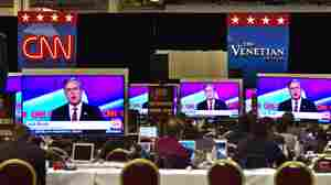 Members of the media watch a Republican presidential debate on cable channel CNN last December.