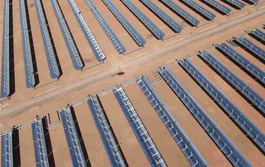 The Ouarzazate power plant in Morocco works by using curved mirrors to concentrate the sun's energy and heat a liquid inside of pipes. That heat is then used to convert water into steam and turn turbines.