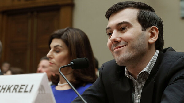 Martin Shkreli, former CEO of Turing Pharmaceuticals, smiles beside Nancy Retzlaff, Turing's chief commercial officer, during a House Oversight and Government Reform Committee hearing on Capitol Hill on Thursday. (Mark Wilson/Getty Images)