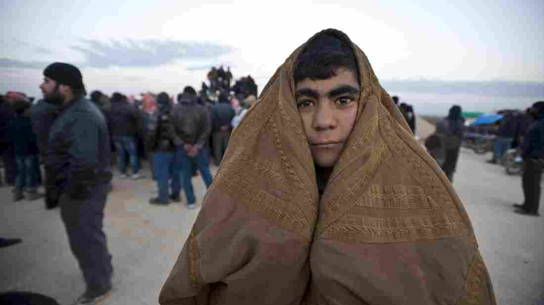 A Syrian man is among the thousands who have fled the fighting in and around the northern city of Aleppo. Thousands of Syrians have gathered at the Bab al-Salam crossing in an attempt to enter Turkey, which has kept the gate closed. Syrian government troops, assisted by Russian airstrikes, have been making gains in the Aleppo area.
