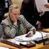 Hillary Clinton, then secretary of state, checks her cellphone after her address at a United Nations meeting in 2012.