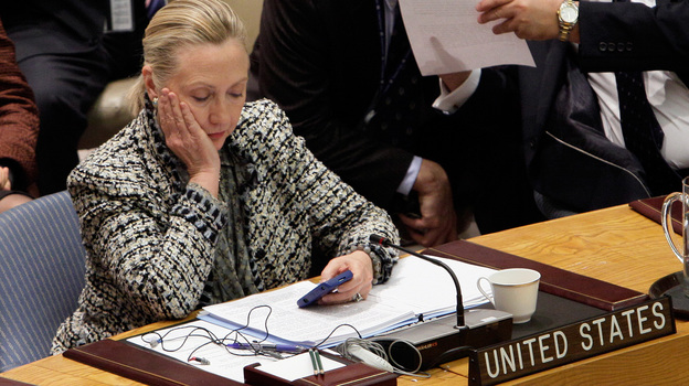 Hillary Clinton, then secretary of state, checks her cellphone after her address at a United Nations meeting in 2012. (AP)