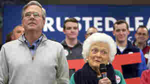 Former first lady Barbara Bush, mother of Republican presidential candidate Jeb Bush, campaigns with her son (left) at a town hall meeting at West Running Brook Middle School in Derry, N.H.