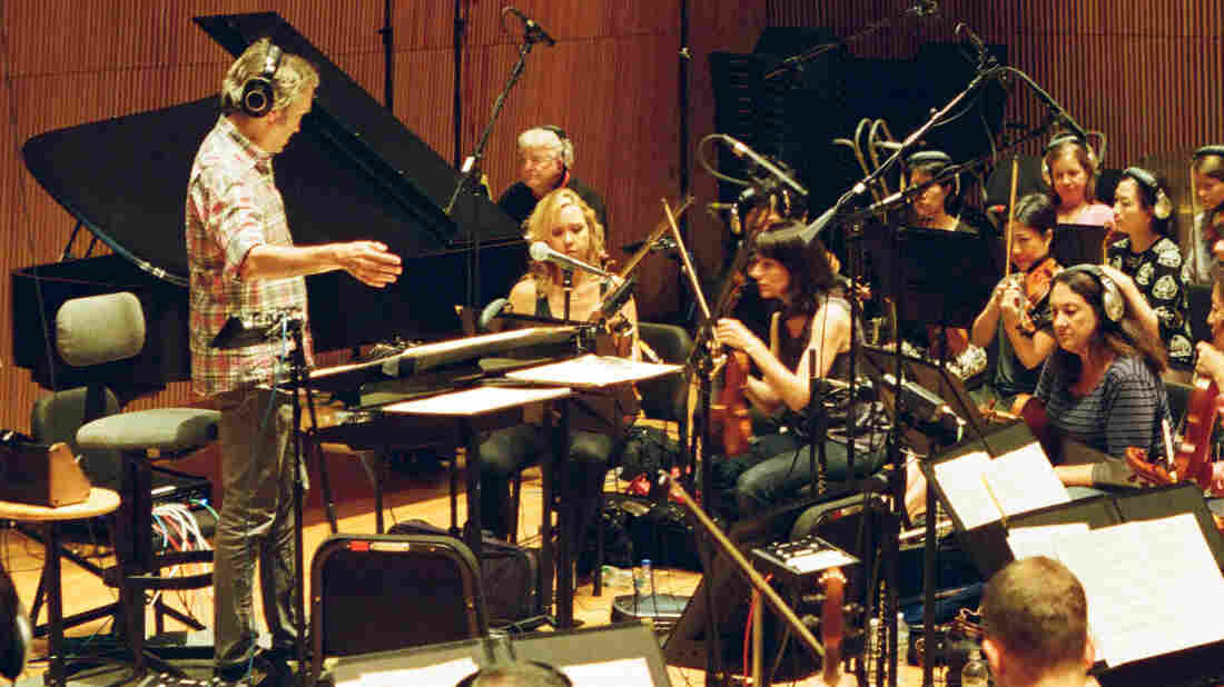 Carter Burwell conducts at a scoring session for Hail, Caesar! at the DiMenna Center in New York.