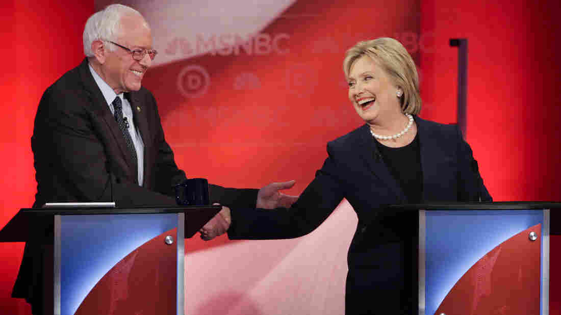 Bernie Sanders and Hillary Clinton shake hands at the University of New Hampshire in Durham on Thursday during the final debate for Democratic presidential hopefuls before the New Hampshire primary.